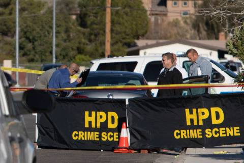 The Henderson Police Department investigates a homicide Friday afternoon, March 27, 2020, in a ...