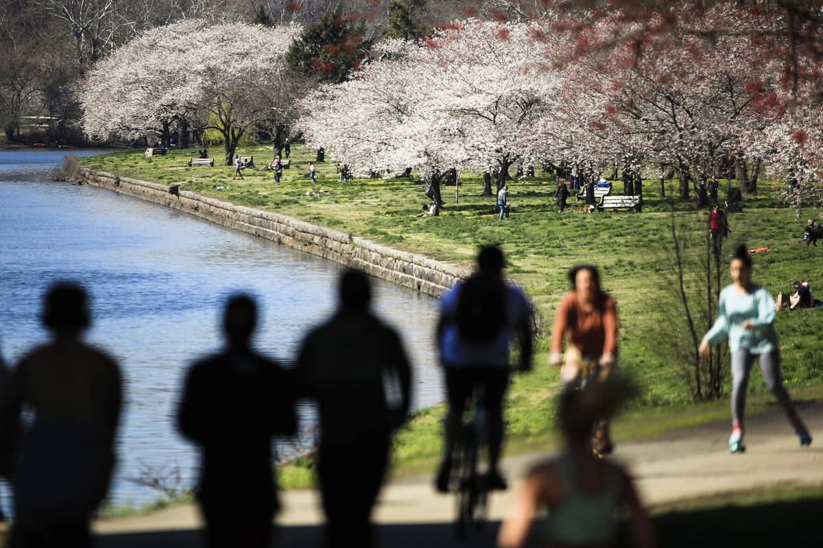 In a March 26, 2020, file photo, people exercise on the trail along Kelly Drive in Philadelphia ...
