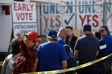 People wait in line to vote early at the Culinary Workers union Monday, Feb. 17, 2020, in Las V ...