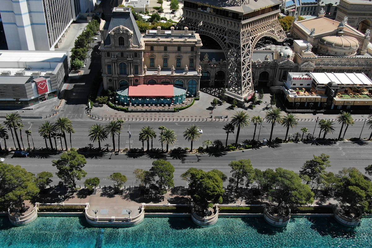 The sidewalks in front the Bellagio and Paris Las Vegas on the Las Vegas Strip are vacant, Frid ...