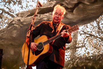 FILE - This June 15, 2019 file photo shows John Prine performing at the Bonnaroo Music and Arts ...