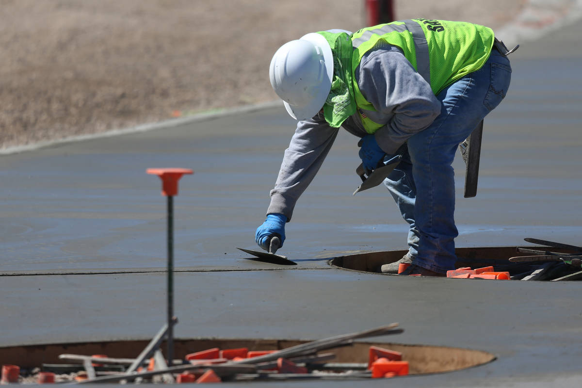 A worker resurfaces concrete at the Raiders Allegiant Stadium in Las Vegas, Tuesday, March 24, ...