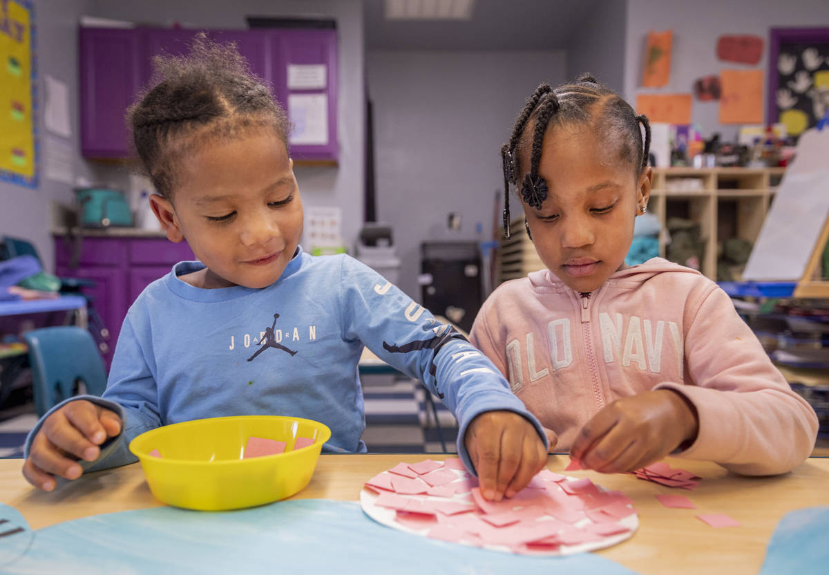 Ka'Mari Wilkerson, 3, left, and Ka'Niyah Wilderson, 5, decorate an Easter Bunny at the Discover ...