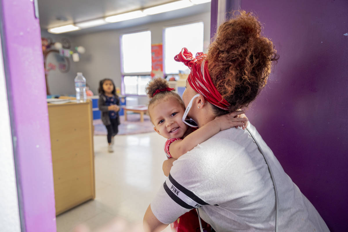 Sarah Washington picks up her daughter Snow Walls, 2, from the Discovery Gardens Childcare Bona ...