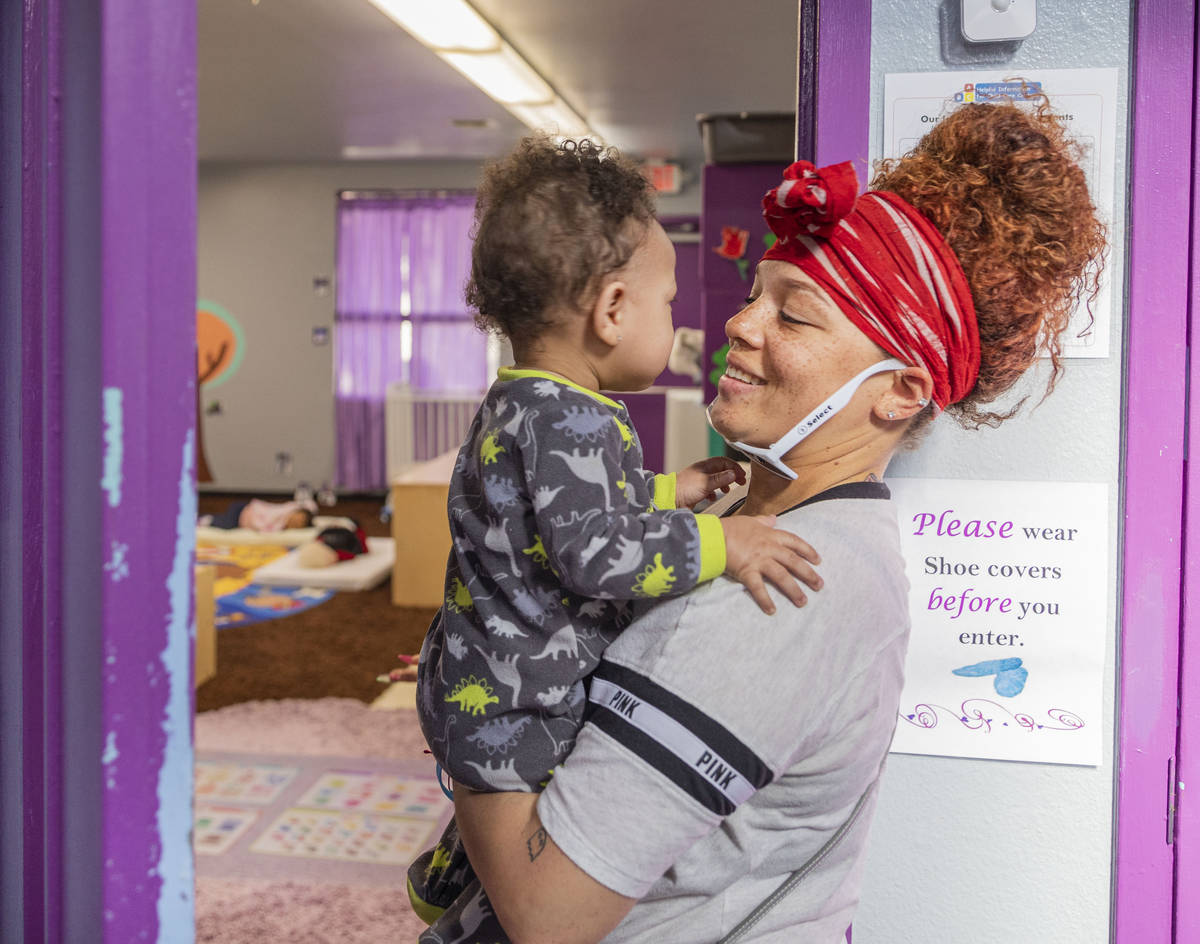 Sarah Washington picks up her son Price Wall, 9 months, from the Discovery Gardens Childcare Bo ...