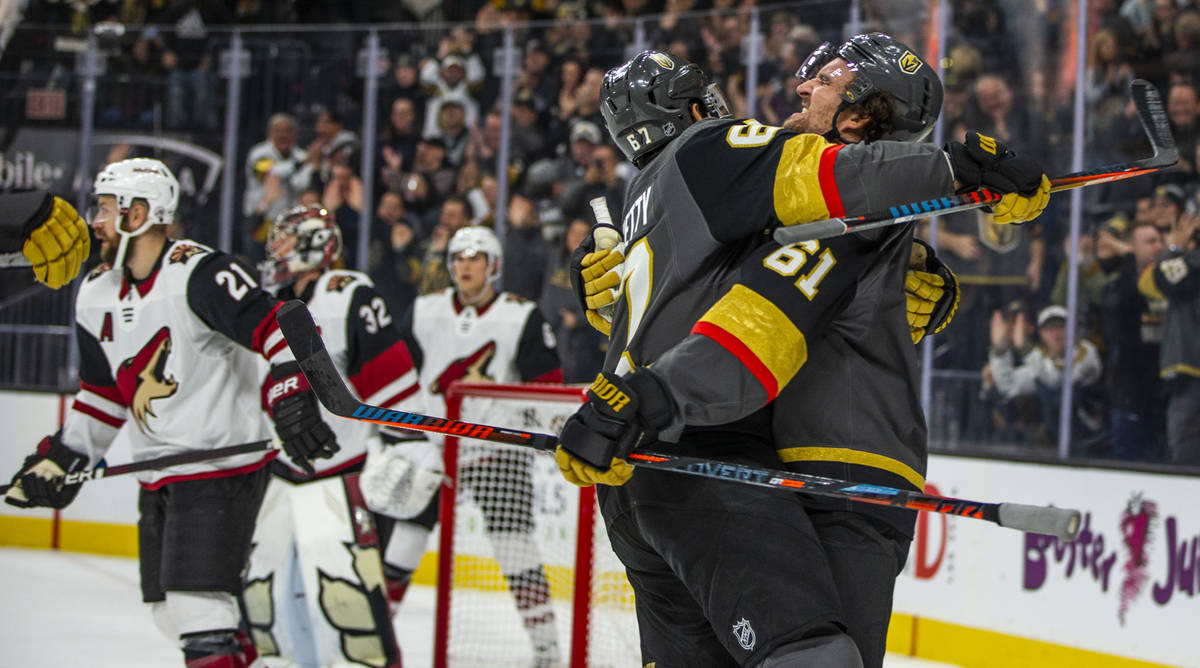 Vegas Golden Knights left wing Max Pacioretty (67, left) celebrates a goal by Vegas Golden Knig ...