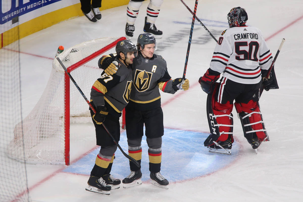 Vegas Golden Knights left wing Max Pacioretty (67) celebrates a score with right wing Mark Ston ...