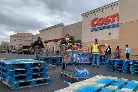 Shoppers push the carts in front of Costco at 791 Marks St, in Henderson on March 29, 2020. Man ...