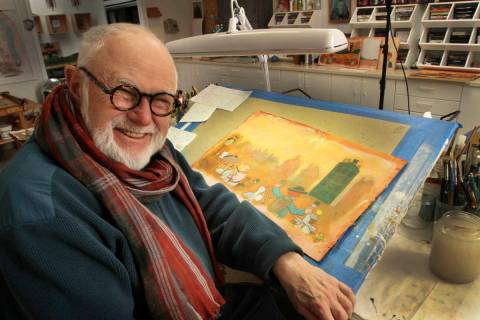 In this photo taken Sunday Dec. 1, 2013, Tomie dePaola poses with his artwork in his studio in ...