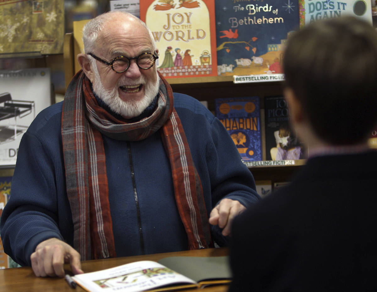 In this photo taken Sunday Dec. 1, 2013, Tomie dePaola laughs as he signs books at the Morgan H ...