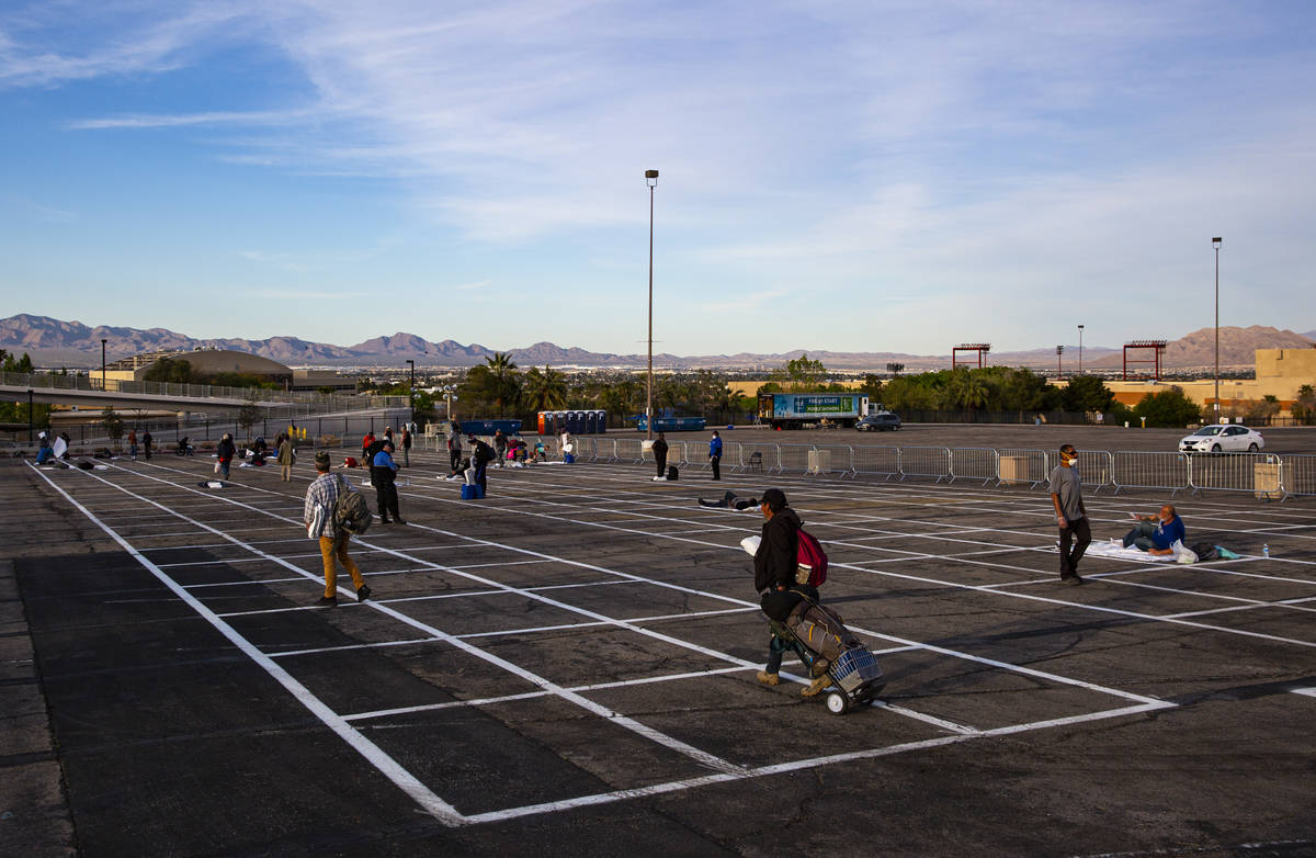 Homeless people enter a temporary shelter in the upper parking lot at Cashman Center due to the ...
