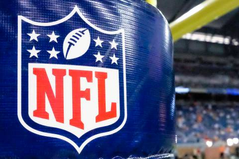 FILE - This Aug. 9, 2014 file photo shows an NFL logo on a goal post pad before a preseason NFL ...