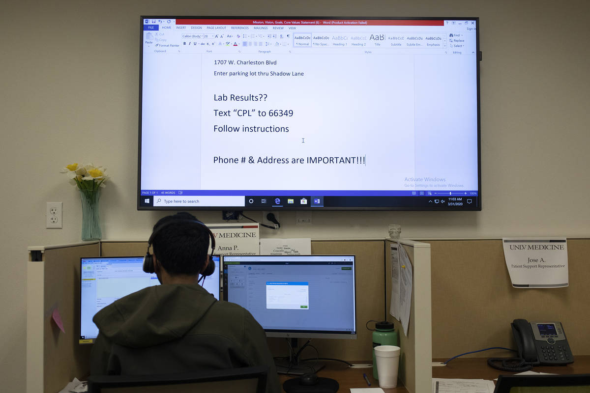 UNLV medical students and residents volunteer to answer calls from community members to determi ...