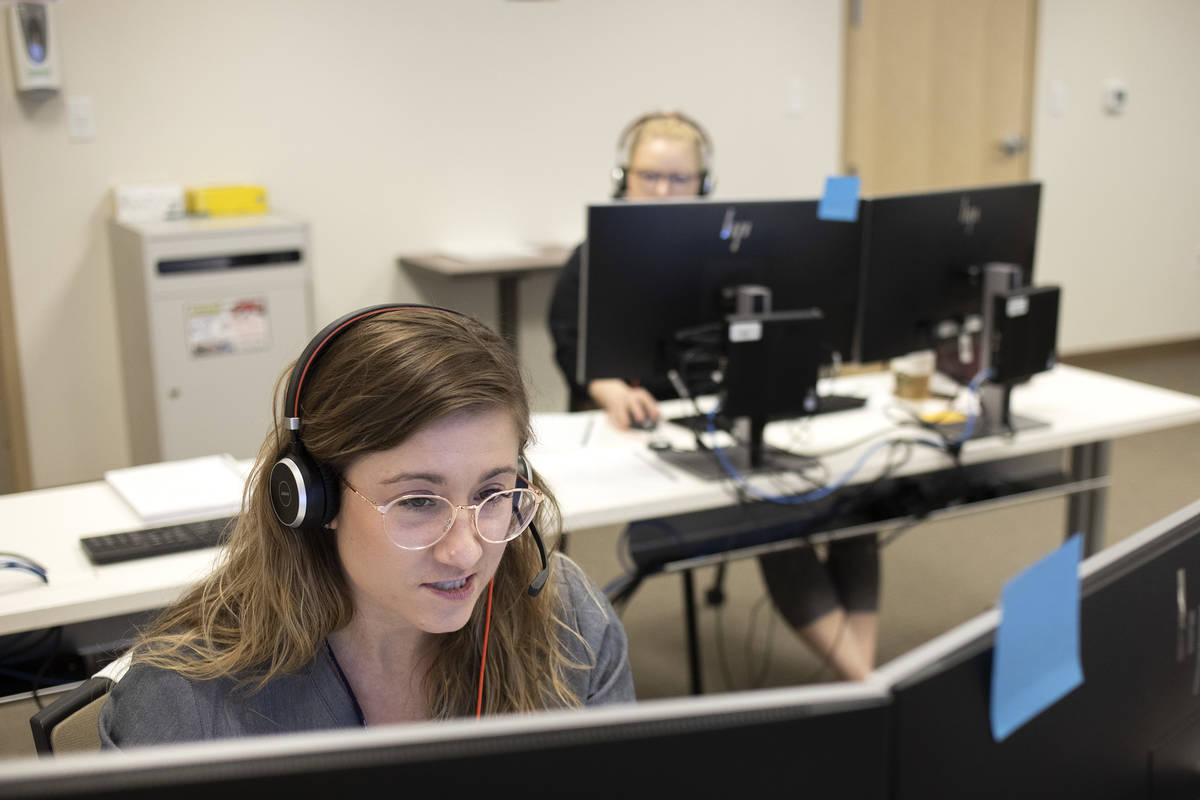 Danyelle Myers, a third-year OBGYN resident, answers calls at a COVID-19 call center at a UNLV ...