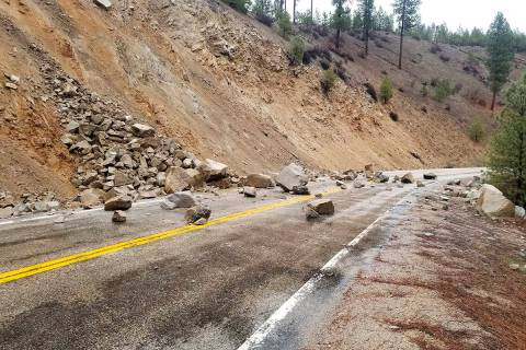 This photo provided by Tyler Beyer shows a rockslide on Highway 21 near Lowman, Idaho, after a ...