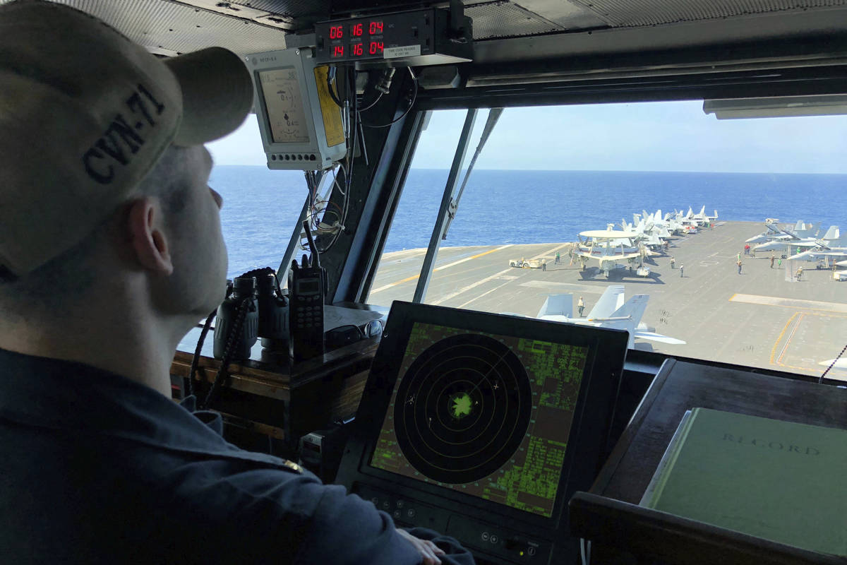 FILE - In this April 10, 2018, file photo, a U.S. Navy crewman monitors on the deck of the U.S. ...