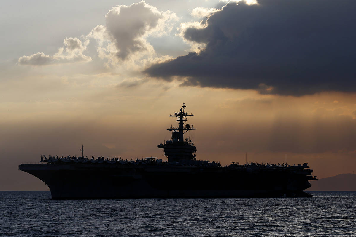 FILE - In this April 13, 2018, file photo the USS Theodore Roosevelt aircraft carrier is anchor ...
