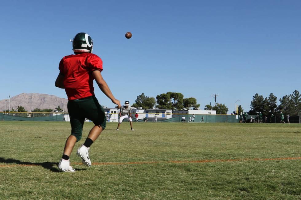 Rancho High School quarterback Ruben Vasquez throws the football as the football team practices ...