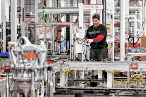 Teakgro Ventra assembles a drive unit at the Tesla Gigafactory, east of Reno, on Tuesday, Dec. ...