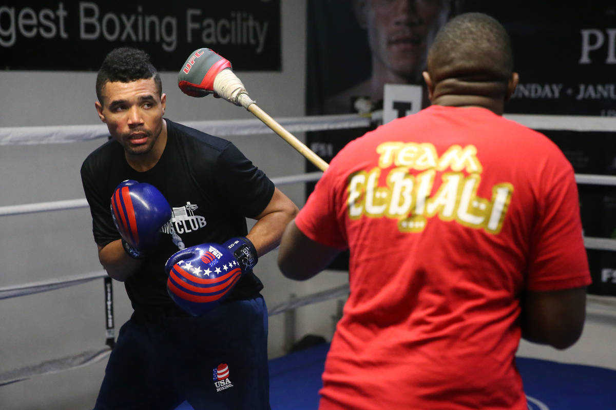 Rahim Gonzales, left, with his assistant trainer Marvin Rutta, during a workout at City Boxing ...