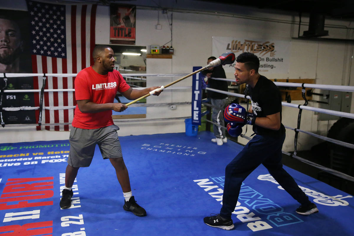 Rahim Gonzales, right, with his assistant trainer Marvin Rutta, during a workout at City Boxing ...