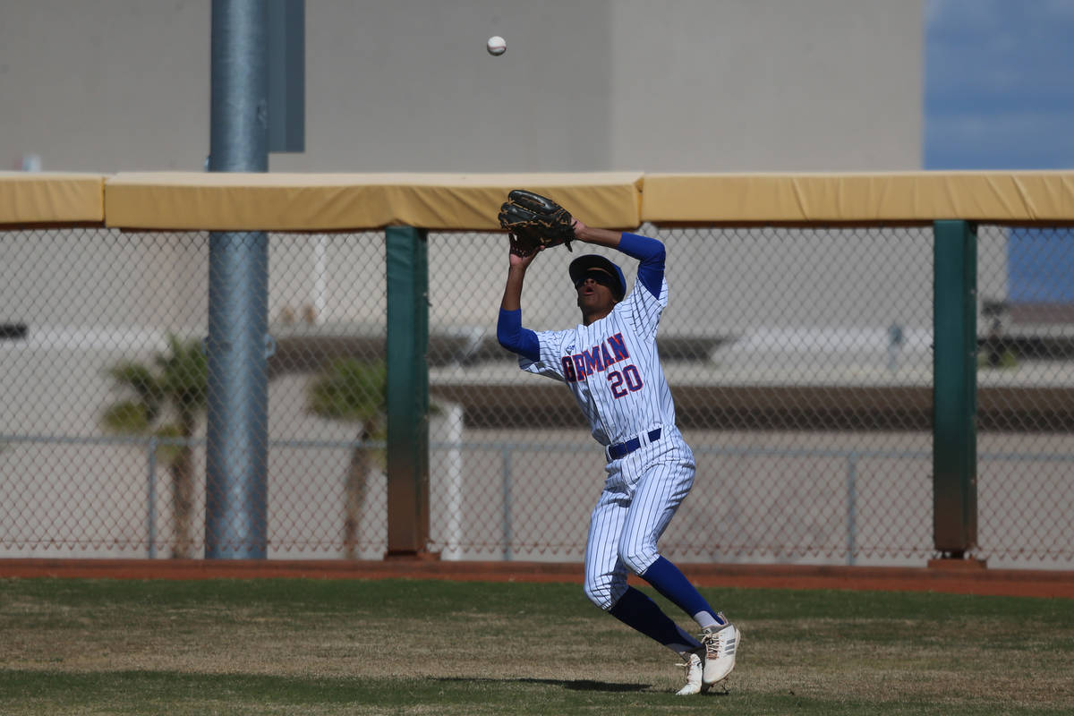 Bishop Gorman's Noah Gulley (20) makes a catch in the outfield against Desert Oasis in the base ...