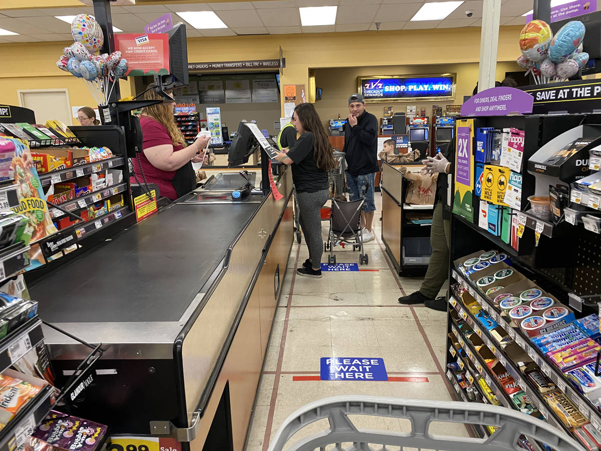 Floor markings to keep shoppers six feet apart at Smith's at 850 S. Rancho Drive in Las Vegas T ...