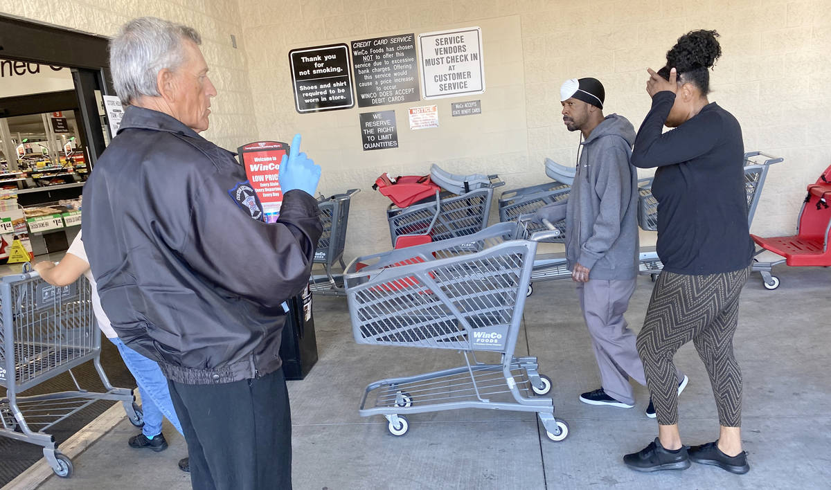 A security guard counts shoppers at WinCo Foods at 7501 Washington Ave. in Las Vegas Tuesday, M ...