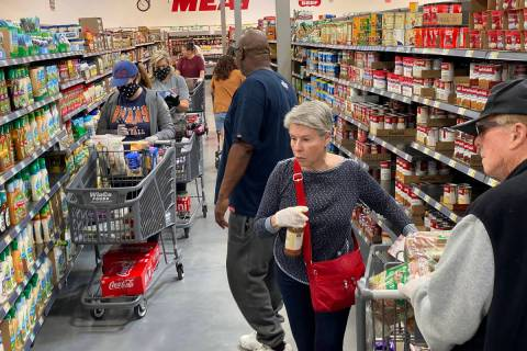 Shoppers at WinCo Foods at 7501 Washington Ave. in Las Vegas Tuesday, March 31, 2020. (K.M. Can ...