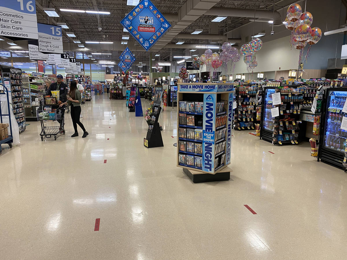 Floor marking to keep shoppers six feet apart at Albertsons at 1650 N. Buffalo Dr. in Las Vegas ...
