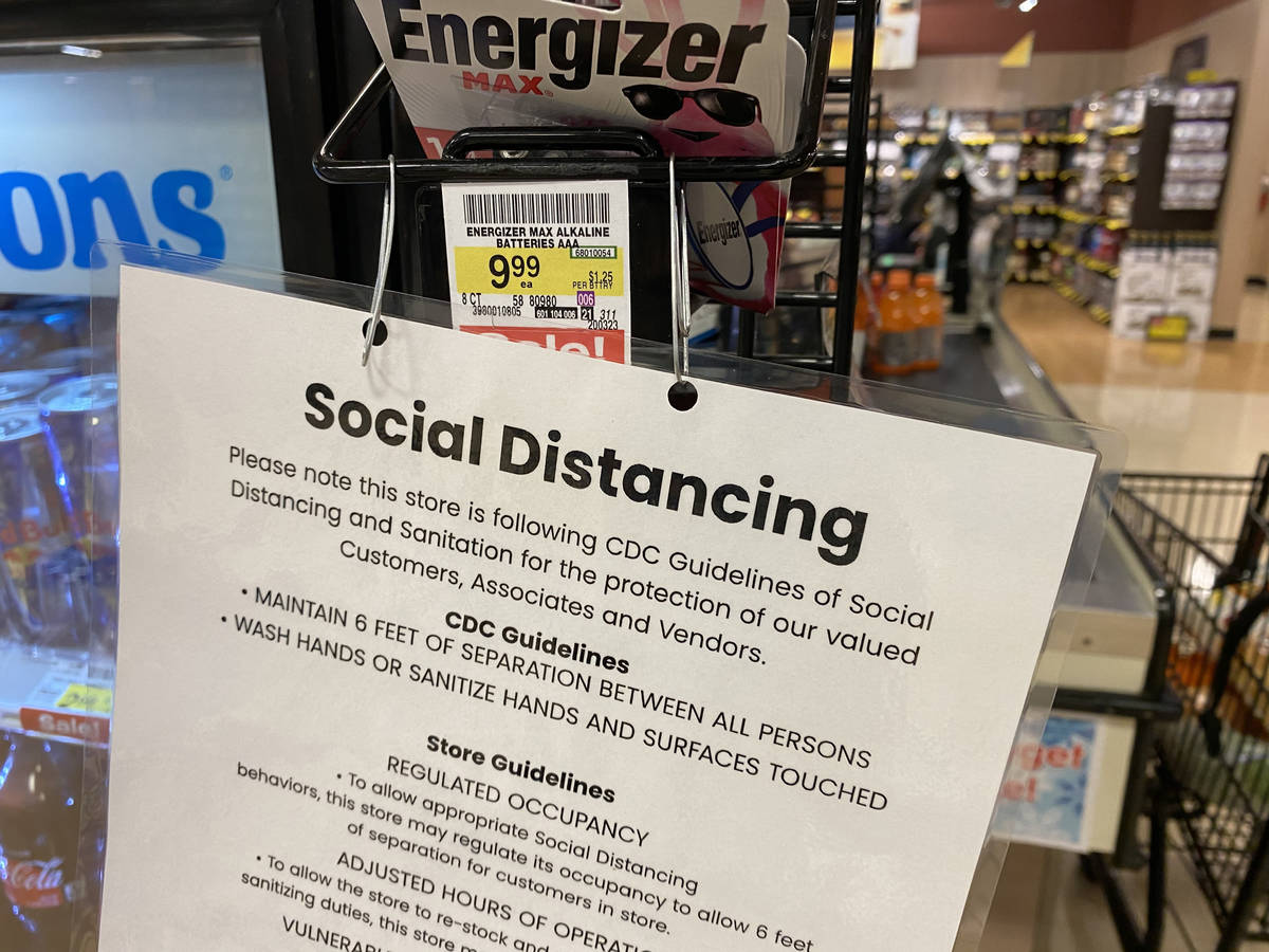 Social distancing information at Albertsons at 1650 N. Buffalo Dr. in Las Vegas Tuesday, March ...