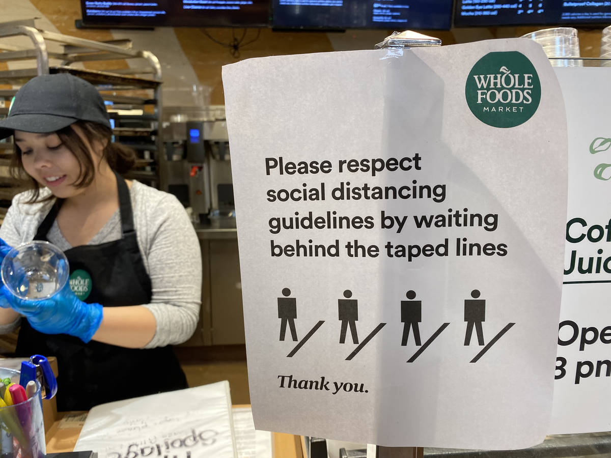 Social distancing information at Whole Foods at 8855 W. Charleston Blvd. in Las Vegas Tuesday, ...