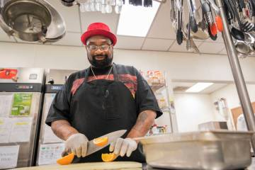 Chef Lester Johnson prepares meals at Martin Luther King Jr. Senior Center that is closed down ...