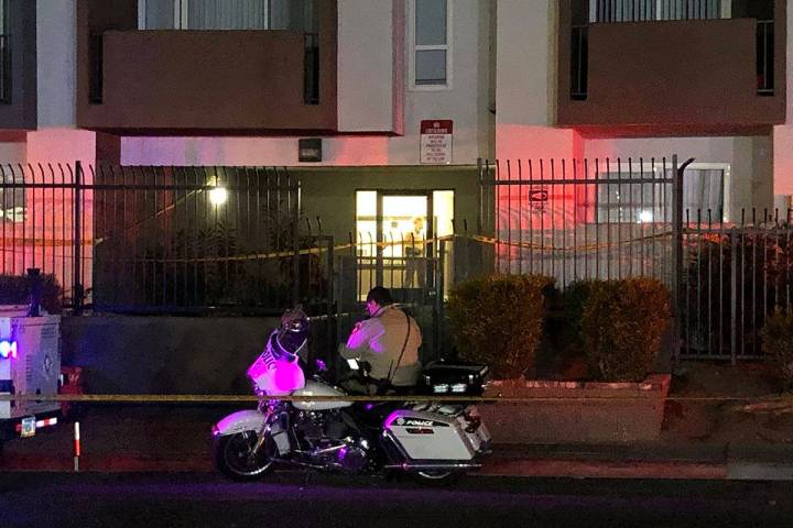 A Las Vegas Metropolitan Police Department motorcycle officer outside of an apartment building ...