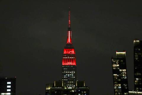 The Empire State building is lit in red and white lights to honor emergency medical workers Tue ...