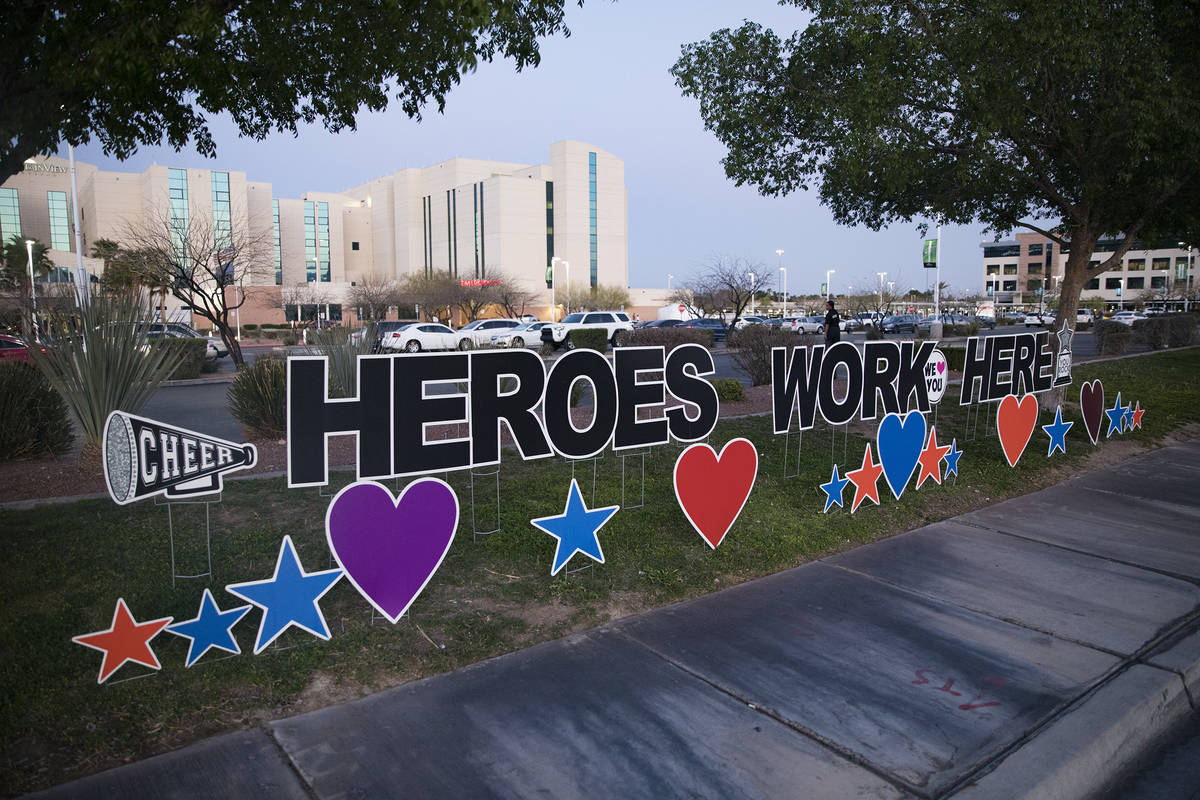 A sign on the grass outside Mountain View Hospital in Las Vegas, Wednesday, April 1, 2020. The ...