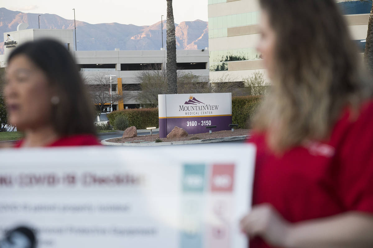 Dina Armstrong, a nurse and chief nurse for National Nurses Untied, left, addresses the media a ...
