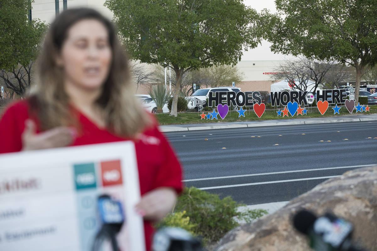 Nicole Koester, a nurse and representative for National Nurses United, addresses the media abou ...