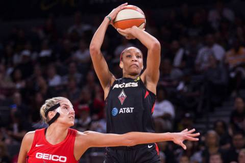 Las Vegas Aces center A'ja Wilson (22) shoots over Washington Mystics forward Elena Delle Donne ...