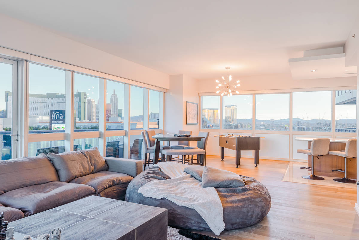 The condo has a large living room. (Red Luxury Real Estate)