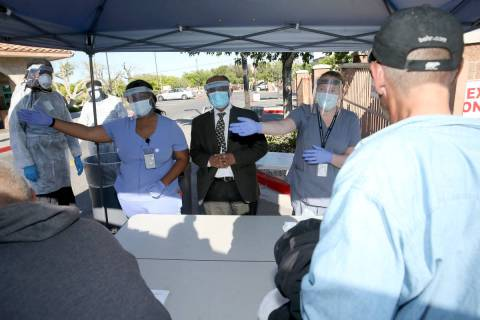 Southern Nevada Health District Community Health Nurse Chika McTier, from left, Dr. Praveen Sar ...