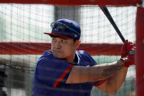 Texas Rangers' Shin-Soo Choo bats during spring training baseball practice Monday, Feb. 17, 202 ...
