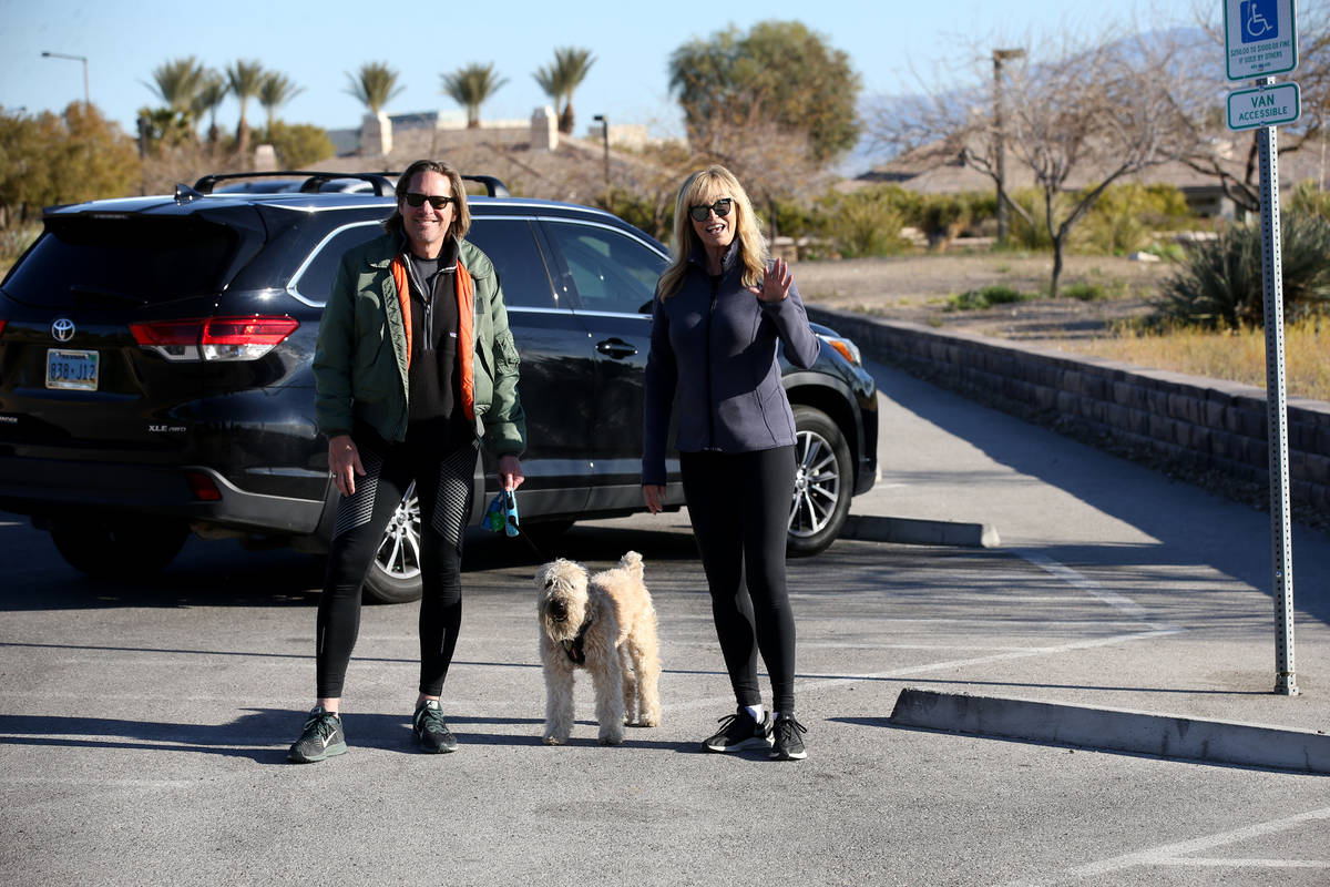 Model, actress and singer Susan Anton and her husband actor Jeff Lester of Las Vegas walk their ...