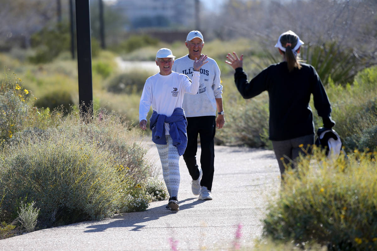 Mike and Ellen Jones, left, wave at Lois Widell, all of Las Vegas, at Hualapai Canyon hiking ar ...
