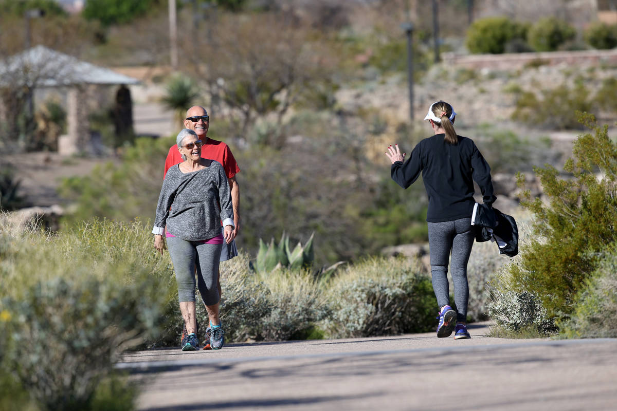 Stan and Mary Jane Antrim, left, smile at Lois Widell, all of Las Vegas, at Hualapai Canyon hik ...