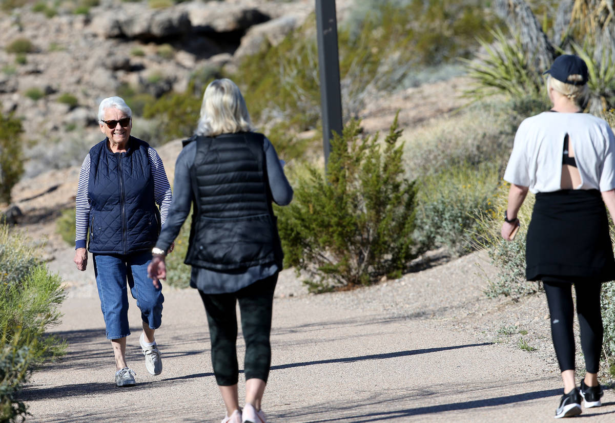 Gretchen Sederman, 83, smiles at Kelly Iriye, right, and Stephanie Cearlock, all of Las Vegas, ...