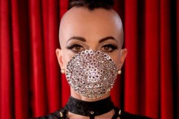 "Michelle L'Amour, creator of ""Quarantine Cabaret,"" is shown with her customized pandemic mask. ..."