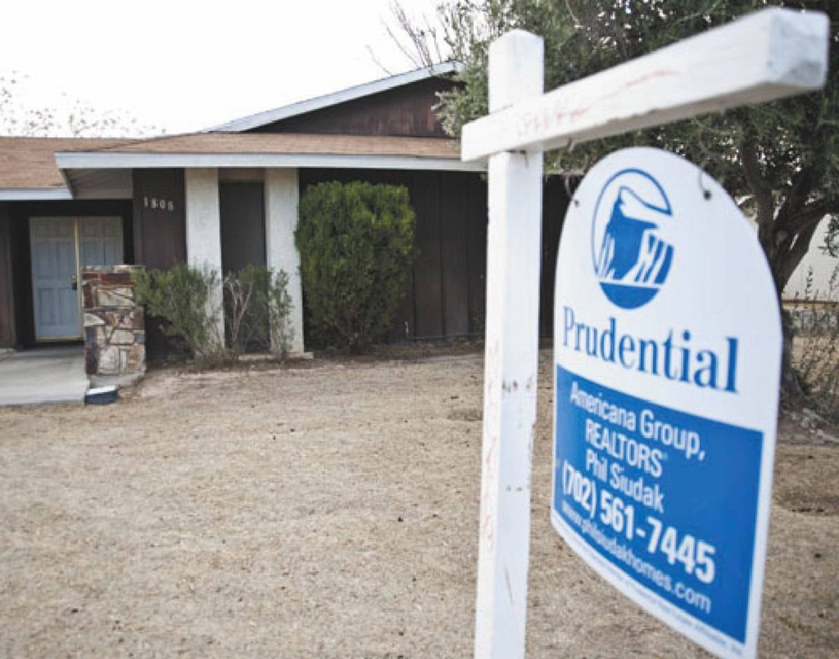 A Realtor sign is shown posted outside a foreclosed upon house in a Las Vegas neighborhood in a ...