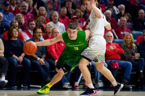 In this Feb. 22, 2020, file photo, Oregon guard Payton Pritchard (3) drives against Arizona dur ...