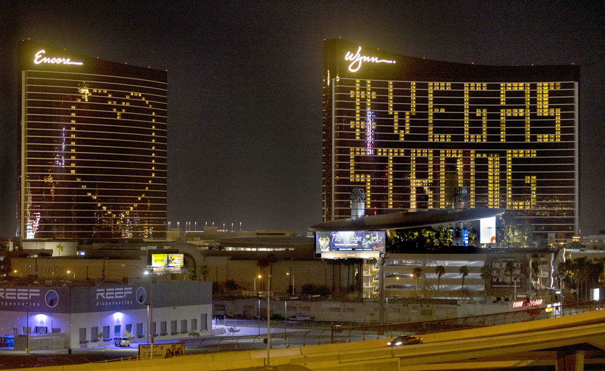 The exterior lights at Encore and Wynn are turned off with the resort strategically illuminatin ...